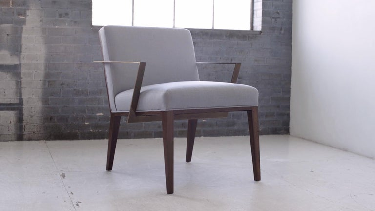 Our refined Caden lounge chair adds elegance to any space. Set two in front of a fireplace, another pair at the end of your bed, or they'll sit perfectly with your living room sofa. A modern and sleek Silhouette. Pictured here crafted in solid