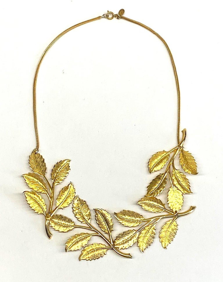 Typical of their unique and creative designs this necklace by Cadoro is comprised of four large branches of laurel leaves, the symbol of victory. Each branch is 1.75 inches wide and 2.88 inches long. The four pieces comprise the front bib of the