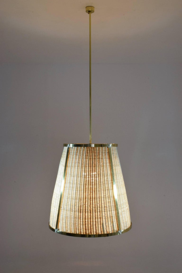 Caeli definition latin air contemporary handcrafted pendant light fixture composed of a polished solid