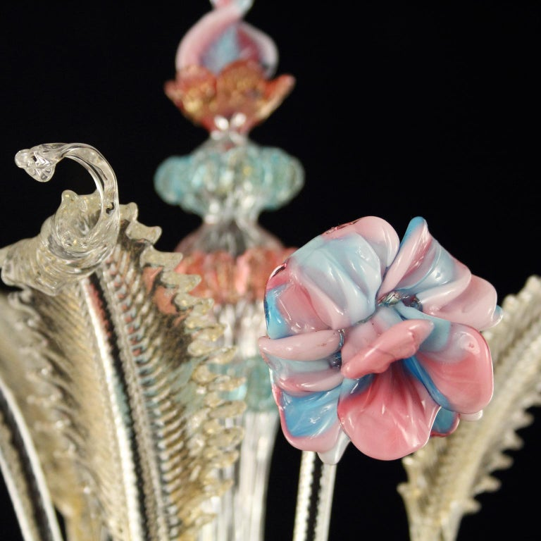 Caesar wall 3-light, crystal and gold, vitreous paste flowers, details in pink and light blue by Multiforme. The name, as well as the structure evokes the splendor of the past centuries. It is an evergreen model, a Classic product manufactured by