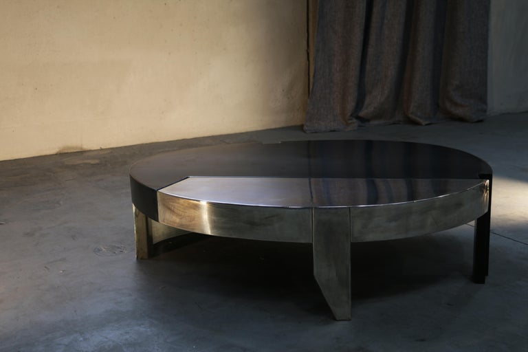 Natural iron / silver plated brass.  Contemporary coffee table born thinking at coffee bean, made with iron oiled finished and silver plated brass, these two materials given it intense taste, like a cup of coffee.
