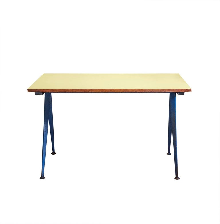 Compas table, model Cafétéria n. 512 table, designed by Jean Prouvé  Bent sheet steel and laminated wood.  In yellow and blue.