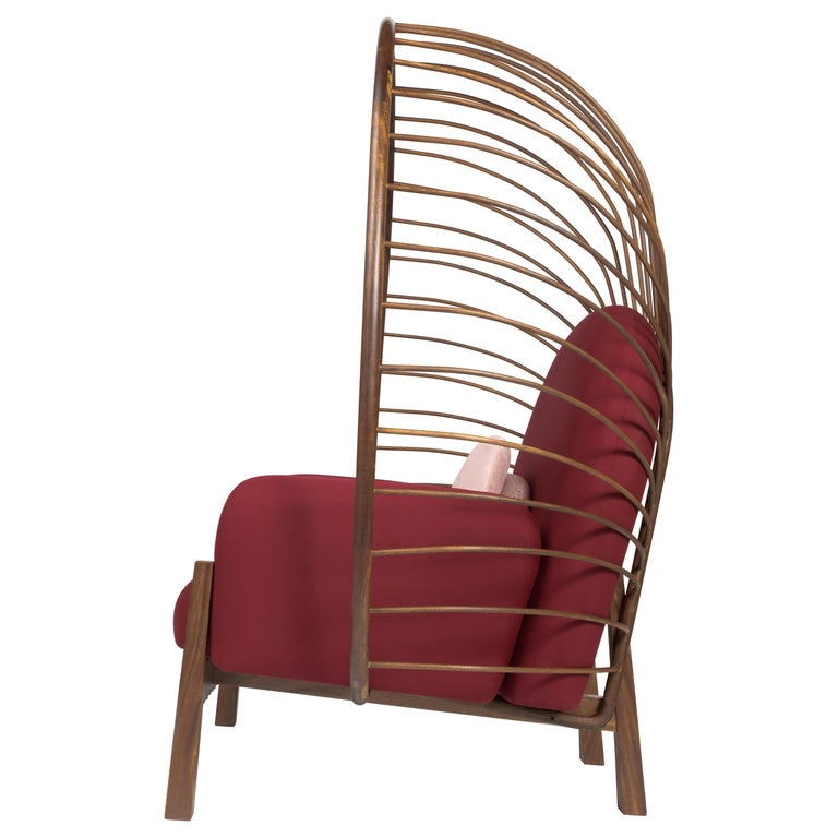 This elegant and striking armchair was designed to highlight outdoor spaces with its magnitude and organic form. Perfect for a relaxing outdoor area. One can almost feel protected by its crown backing. Made of solid tropical Huanacaxtle wood. The
