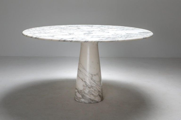 Angelo Mangiarotti designed this Postmodern round dining table in 1972, produced by Skipper, Italy. This is an authentic piece from that era and not a new edition.  Beyond his many architectural feats, Mangiarotti's portfolio includes a wide