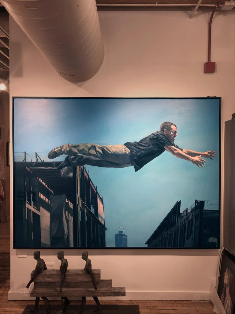Chasing the Edge - Large Scale Oil Painting of Man Leaping Between Buildings - Gray Landscape Painting by Caleb O'Connor