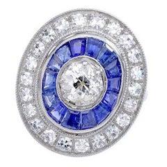 Calibrated Sapphire Diamond Platinum Engraved Ring