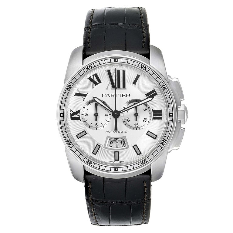 Calibre De Cartier Steel Chronograph Silver Dial Mens Watch W7100046. Automatic self-winding chronograph movement. Round stainless steel case 42.0 mm in diameter. Crown cover with faceted blue spinel. Exhibition case back. Stainless steel concave