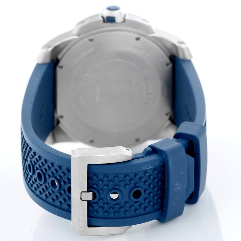 Calibre de Diver Cartier Men's Stainless Steel  Watch WSCA0011 - Automatic winding. Stainless Steel  (42mm diameter). Blue dial with white Roman numerals and stick markers; date at 3 o'clock, subseconds at 6 o'clock. Blue rubber strap with Cartier