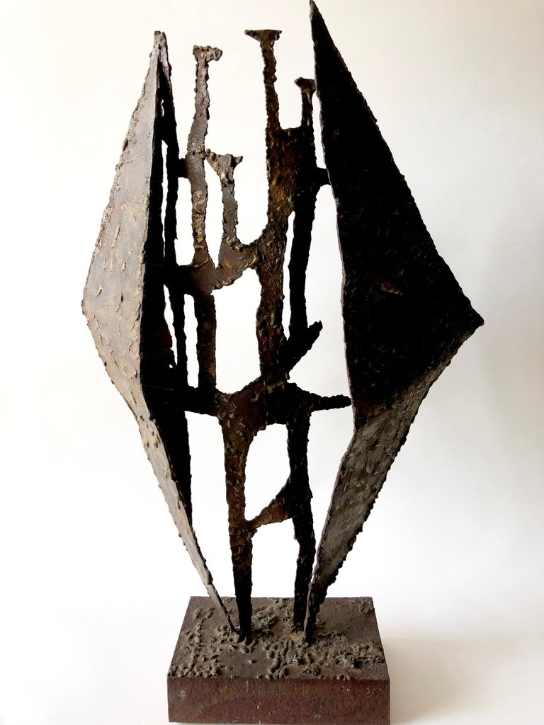 Large-scale metal and brass Brutalist sculpture mounted on wood. Sculpture is from the 1960s or 1970s and measures 28