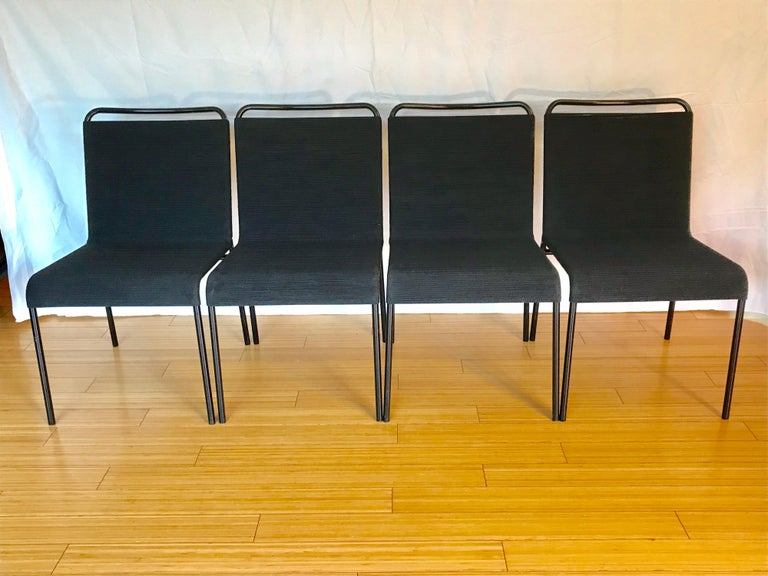 Great modernist designs for California living indoors or out. Enameled black tubular steel with new black sash cotton cord. Minor ware. Great vintage condition. Comfy and stout.