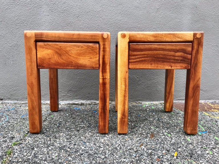A handsome pair of California design tables. Made of solid walnut with a nice grain and inlaid oak wood top design. They've been lightly refinished to their original natural hues.