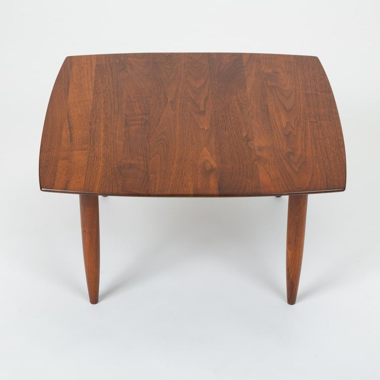Produced by Ace-Hi of Gardena, Calif., the Prelude line of furniture featured solid walnut construction and simplified (but never reductive) purity of form. This Prelude table has a rounded square shape, with slightly bowed edges and a tidy corner