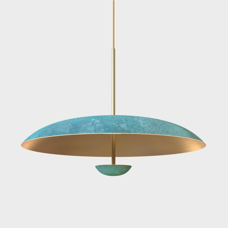 Two finely hand-spun brass plates gently curved make up this pendant light. Inspired by planet-like appearances and textures, a Vedigris patina is applied to create this unique finish. Please note the pieces are handmade, each plate has a slight