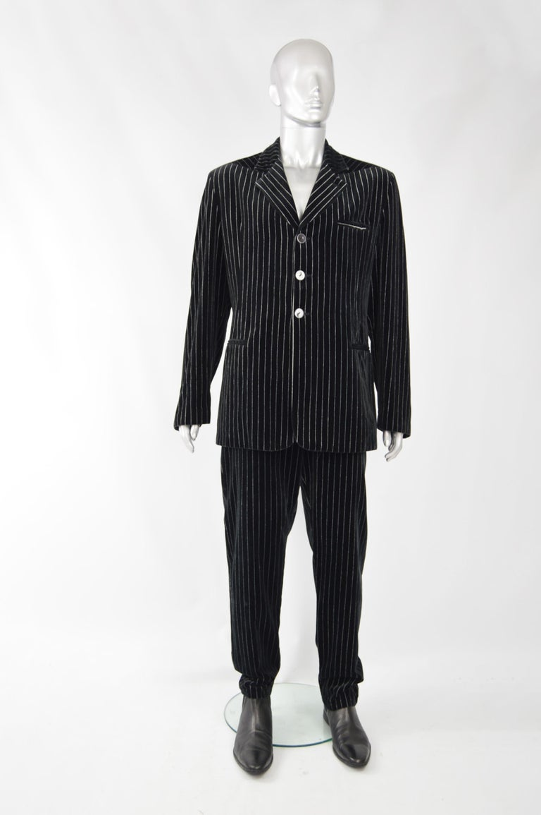 An amazing vintage mens suit from the 80s by genius Italian fashion designer duo, Calugi e Giannelli. In a black velvet with grey pinstripe running throughout.   Size: Jacket Marked 54, Trousers 52 but the jacket fits like a Large and the trousers