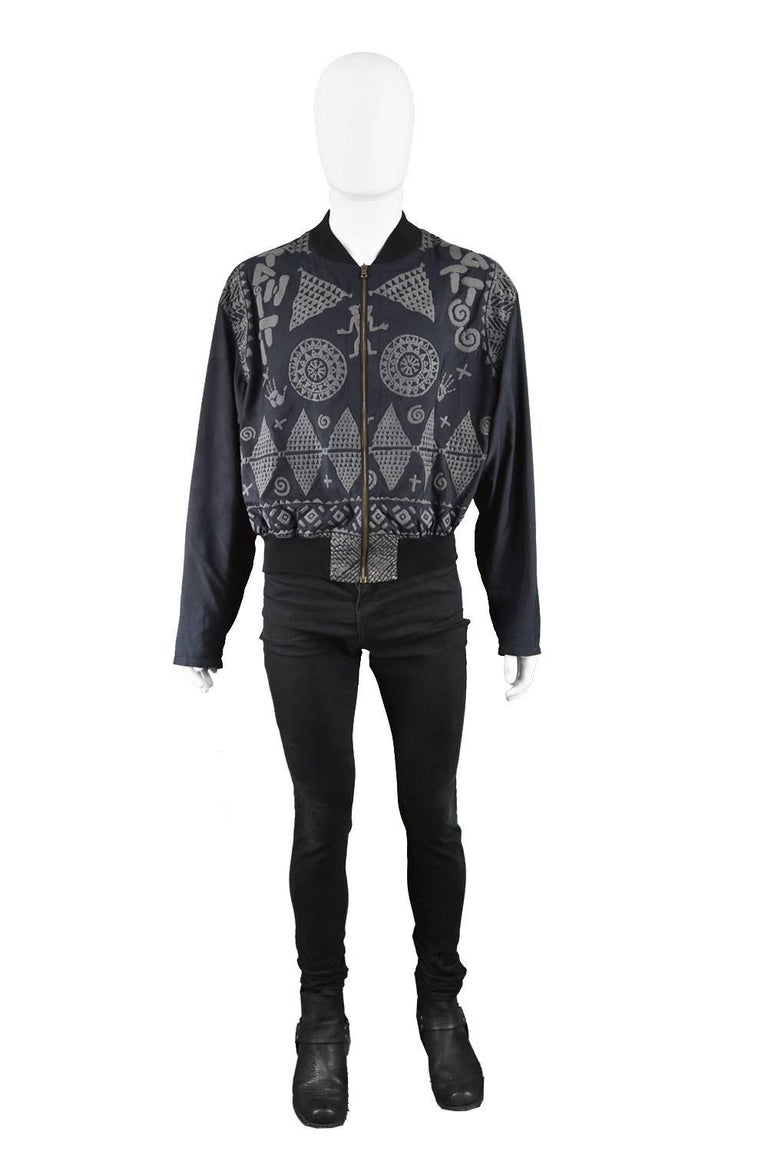 "Calugi E Giannelli Men's Vintage 1980s Rubbery Tribal Pattern Bomber Jacket  Size: Marked 52 which is a men's Medium Large but this gives a looser fit on top like most bomber jackets. Has quite long sleeves. Please check measurements.  Chest - 48"" /"