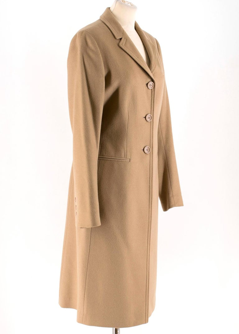 Calvin Klein Camel Wool & Cashmere Blend Coat   - Wool and cashmere blend coat - Long sleeves - Standard notch collar - Front centre snap button closure - Mid-weight - Non functional pockets  Please note, these items are pre-owned and may show signs