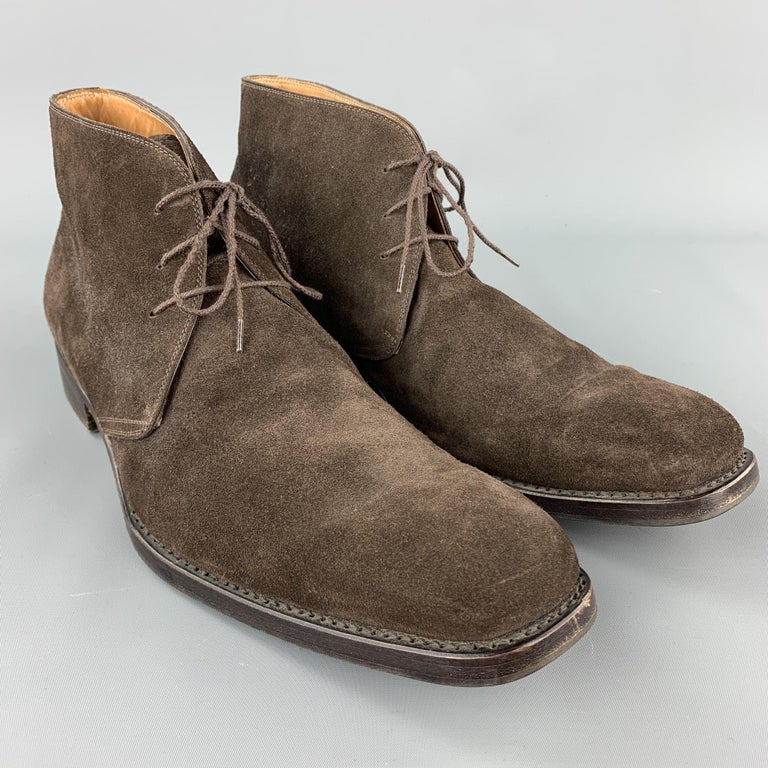 CALZOLERIA HARRIS boots comes in a brown suede featuring a chukka style, lace up, and a wooden heel. Made in Italy.  Very Good Pre-Owned Condition. Marked: 12  Measurements:  Length: 13 in.