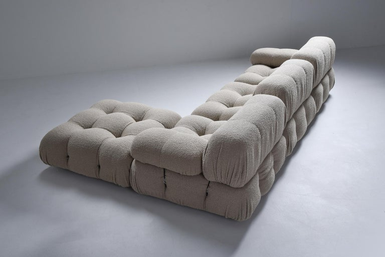 Postmodern modular couch by Mario Bellini in taupe bouclé for B&B Italia in the 1970s. The entire sofa consists of 4 big seating elements, 3 backrests and 2 armrests. The couch has been reupholstered in a grey Bouclé wool. We can assemble your