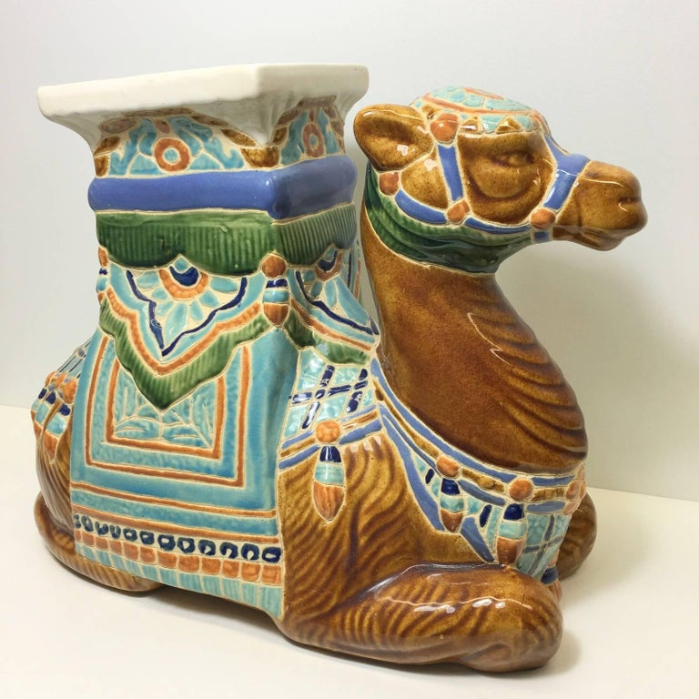 Mid-20th century glazed ceramic camel garden stool, flower pot seat or a unique side table. Handcrafted ceramic. Nice colorful addition to home, office or garden area. Procured in Europe and will be shipped directly from there to buyer.