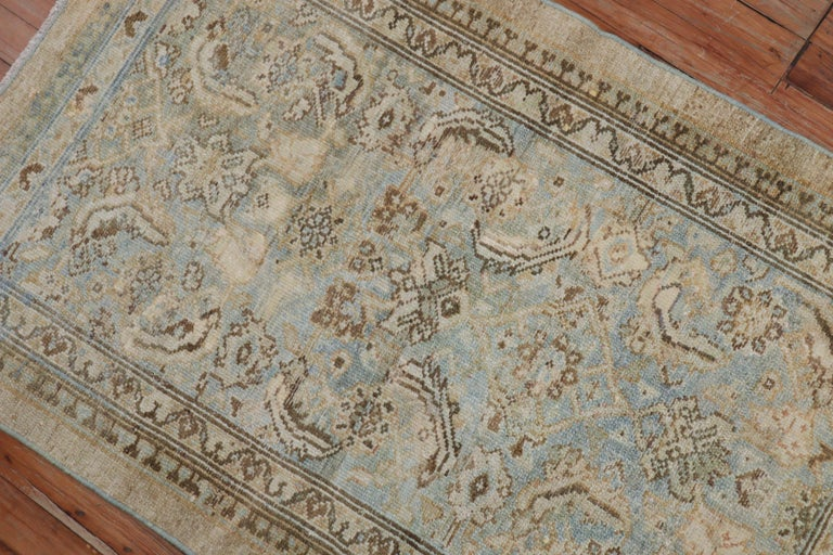 An early 20th century traditional Persian Serab mat in powder blue and camel accents.  Measures: 2'7