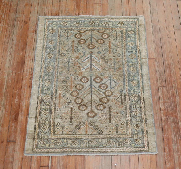 An early 20th century traditional Persian Serab mat in soft brown and sea foam accents on a camel ground  Measures: 2'10