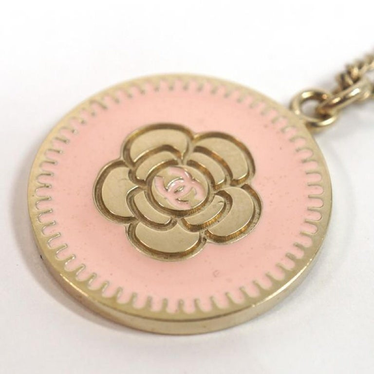 An authentic camelia  coco mark  pendant  coin GP  necklace  pink x Mat gold The outside material is GP. This item is Contemporary. The year of manufacture would be 1986. Rank A beauty goods There is little bit signs of wear, but overall a beautiful