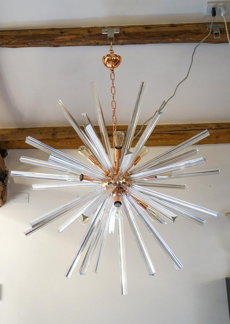 """Designed in 1982 by Camer glass, this chandelier has 43 clear glass elements called """"Triedri"""". Perfect for a modern space, the chandelier reach the diameter of 90 cm and is lighted by 9 Bubs E14 that create a comfortable atmosphere lighting the"""