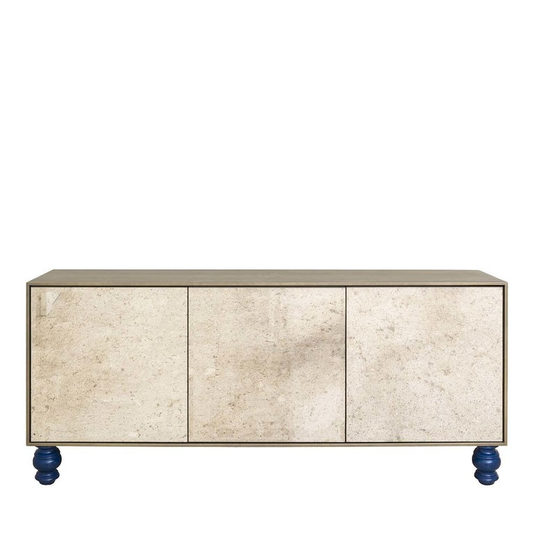 This media storage unit with a wooden structure will add a touch of class to any home or office space. The structure of the piece is in a burnished brass color while three glass doors in beveled, antiqued glass allow for easy storage of items.