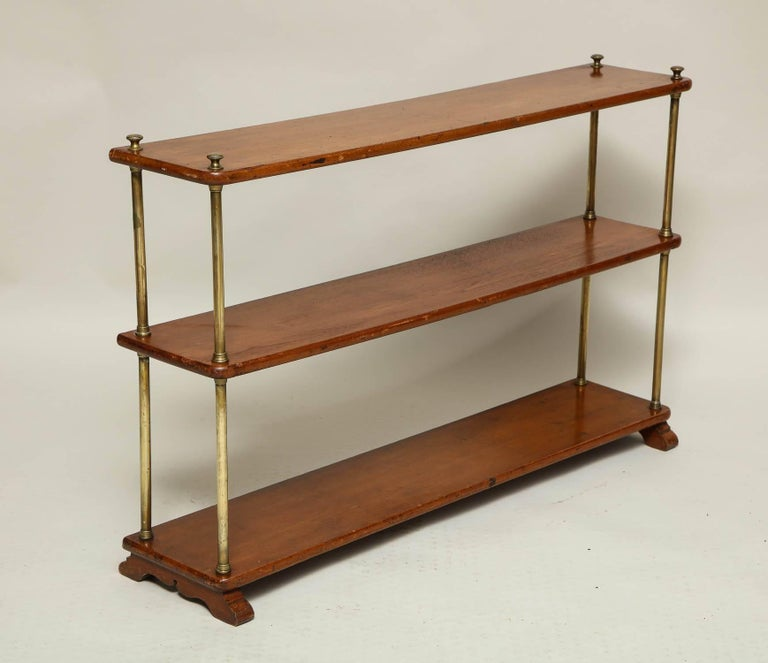 English 19th Century Brass And Mahogany Three Tier Campaign Bookshelf Standing On Scalloped Shoe Feet