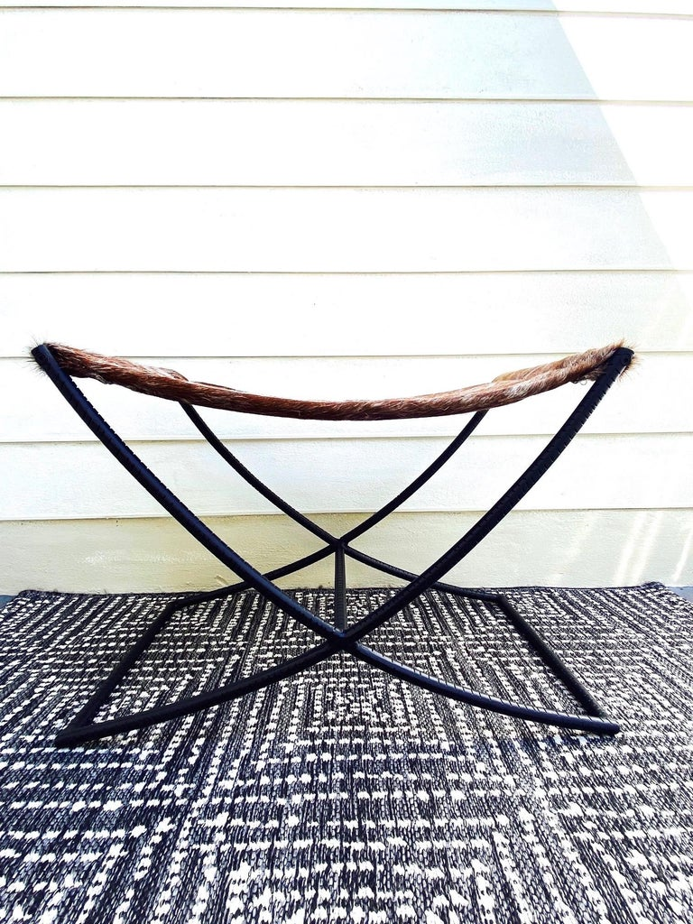 Campaign Style Bench with Brown and White Leather Hide Seat and Iron Base For Sale 4