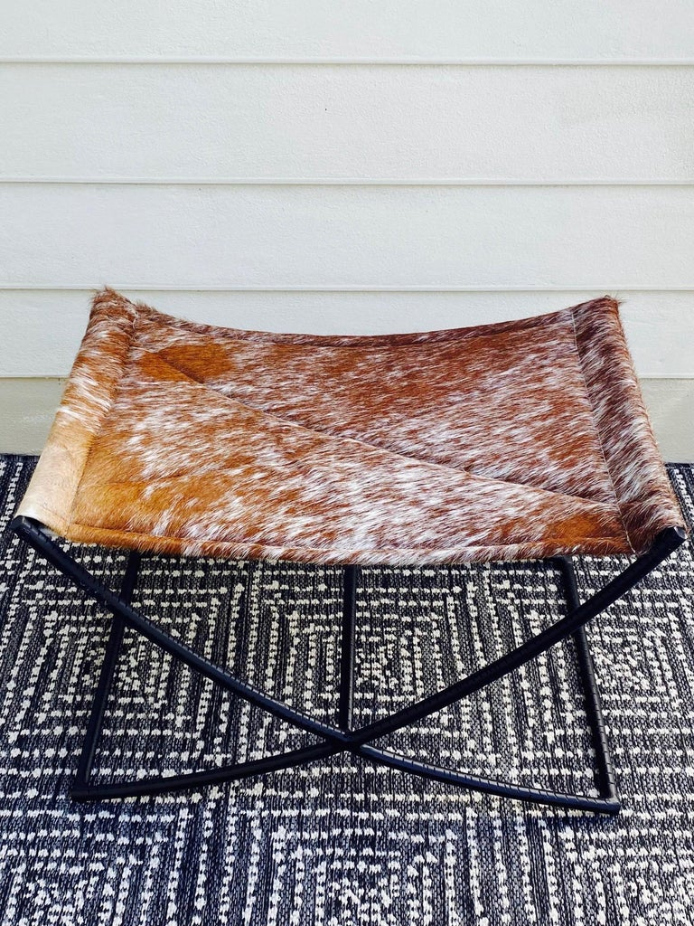 Mid-Century Modern Campaign Style Bench with Brown and White Leather Hide Seat and Iron Base For Sale