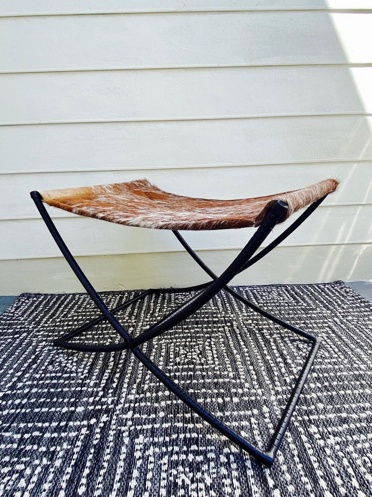 Hand-Crafted Campaign Style Bench with Brown and White Leather Hide Seat and Iron Base For Sale