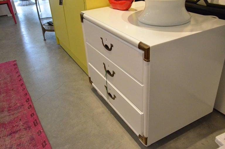 Campaign Style Lacquered White with Brass Accents Bedside Table/Chest of Drawers In Good Condition For Sale In Houston, TX