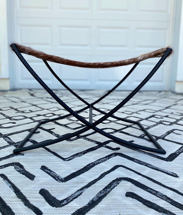 Campaign Style Stool with Brown and White Cowhide Seat and Black Iron Base For Sale 4