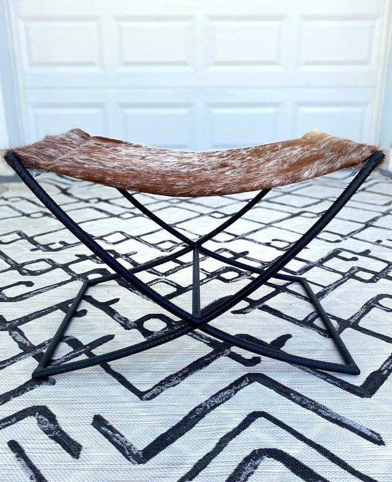 Campaign Style Stool with Brown and White Cowhide Seat and Black Iron Base For Sale 5