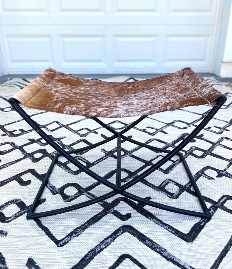 Indonesian Campaign Style Stool with Brown and White Cowhide Seat and Black Iron Base For Sale