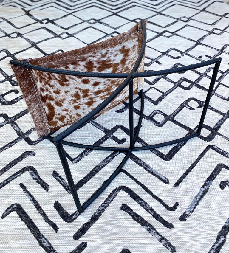 Campaign Style Stool with Brown and White Cowhide Seat and Black Iron Base For Sale 1