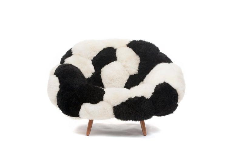 Fernando and Humberto Campana [Brazilian, b. 1961,1953] Prototype Bolotas armchair (Bicolor), 2018 Sheep's wool and Ipê wood 41.25 x 43.25 x 33.5 inches 105 x 110 x 85 cm  The Campana Brothers, Fernando (b. 1961) and Humberto (b. 1953) were