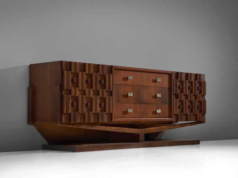 Credenza, walnut, marble and brass, Canada, 1940s.   Large Art Deco sideboard in walnut and brass. This heavy Brutalist credenza seems to float on its elegant, geometric base with stunning bronze detailing. The credenza is equipped with three