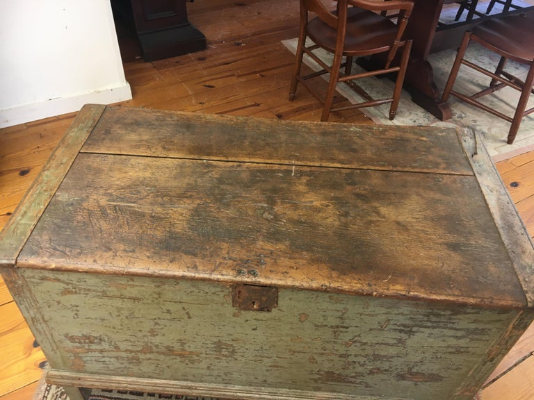 This is the best original painted blanket chest we have found in the last few years. The soft celery green color and wear will grab your attention immediately. There is a candle box holder inside and original hinges. Its simply flawless.