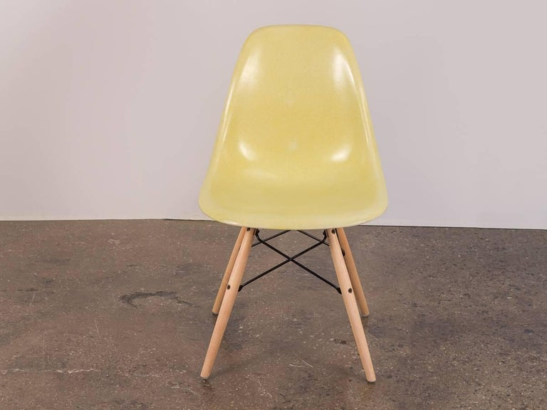 Original 1960s molded fiberglass shell chairs on Maple Dowel Base, designed by Charles and Ray Eames for Herman Miller.  These distinctly thready 1960s shells have a brilliant canary yellow hue that is hard to come by. Shells are in beautiful