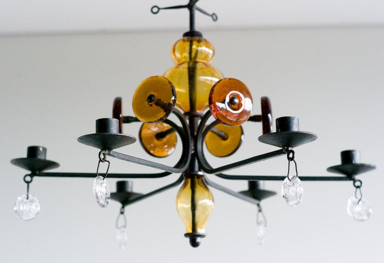 Wrought iron, clear and amber glass six-arm chandelier by Erik Hoglund for Boda.