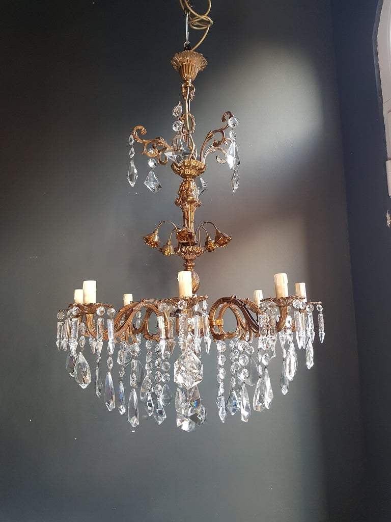 Original preserved chandelier, circa 1950. Cabling and sockets completely renewed. Crystal hand knotted Measures: Total height: 110 cm, height without chain: 83 cm, diameter 70 cm, weight (approximately) 15 kg.  Number of lights: 8 -light Bulub