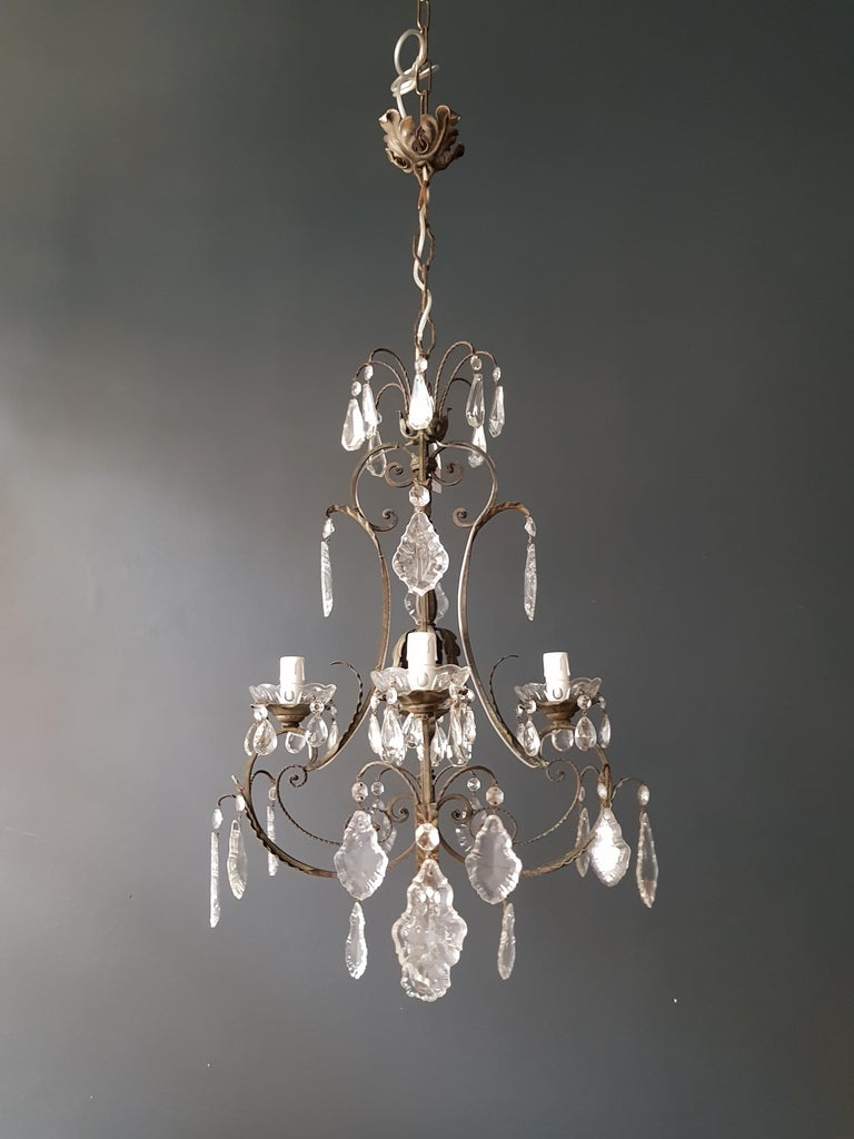 Original preserved chandelier, circa 1950. Cabling and sockets completely renewed. Crystal hand knotted Measures: Total height: 99 cm, height without chain: 73 cm, diameter 50 cm, weight (approximately) 4 kg.  Number of lights: 4 -light Bulub