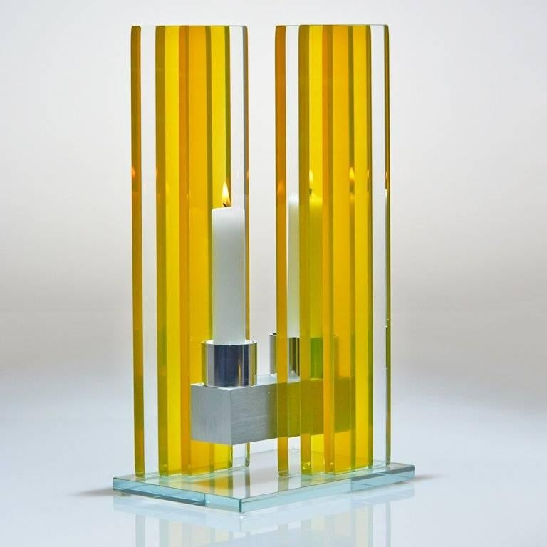 This polished glass, double candleholder from the Unified Light series is designed by world renowned glass artist, Sidney Hutter. With 40 years of experience in the contemporary glass and fine art world, Sidney now creates illuminated designs for