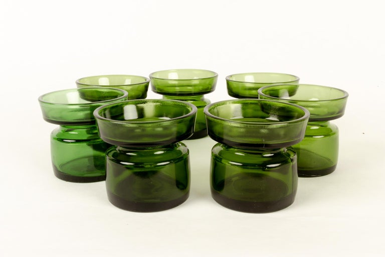 Candleholders by Jens H. Quistgaard for Dansk Designs 1960s set of 7 Set of seven green glass candleholders designed by Danish designer Jens Harald Quistgaard also known as IHQ. Different nuances of green. Makers mark on the bottom: