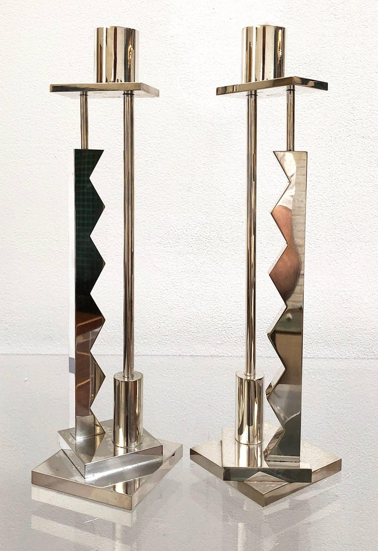 Signed pair of silver plated candlesticks by Ettore Sottsass for Swid Powell. Made in Italy. Price is for the pair.