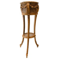 Cane and Carved Wood Plant Stand with Craved Drape Decoration