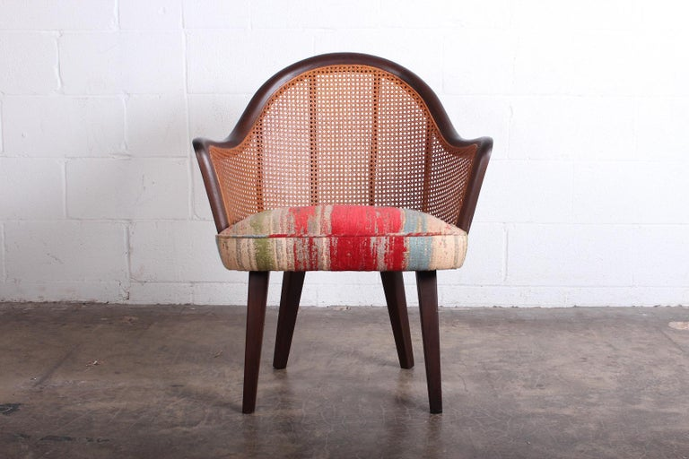 A mahogany and cane armchair attributed to Harvey Probber.