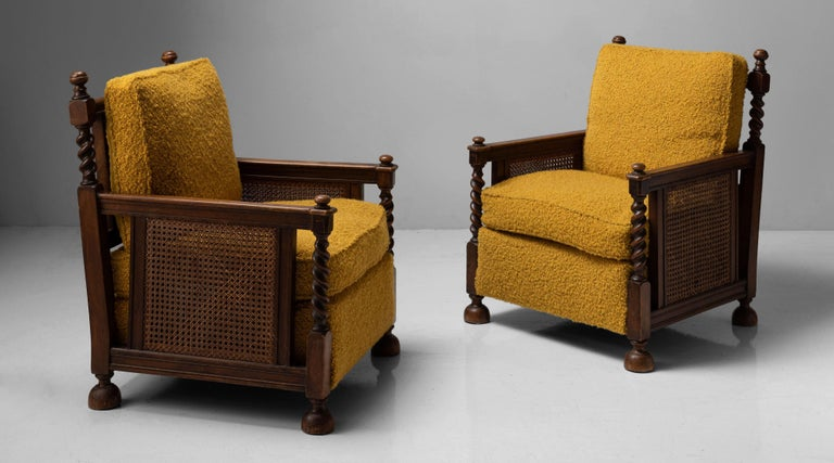 Newly upholstered cushions, oak and hardwood frame with spiral carving and cane sides and back.   Measures: 30